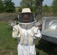 DoD biologist Jacky Ferrer dons a beesuit to remove wasps from a nest box on Fort Hood, TX